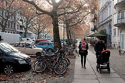 View along street in autumn in gentrified district of Prenzlauer Berg, Berlin Germany