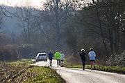 Joggers in country lane, Bourton-on-the-Water , The Cotswolds, United Kingdom