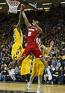 January 19 2013: Iowa Hawkeyes guard Anthony Clemmons (5) tries to block a shot by Wisconsin Badgers forward Ryan Evans (5) during the second half of the NCAA basketball game between the Wisconsin Badgers and the Iowa Hawkeyes at Carver-Hawkeye Arena in Iowa City, Iowa on Sautrday January 19 2013. Iowa defeated Wisconsin 70-66.