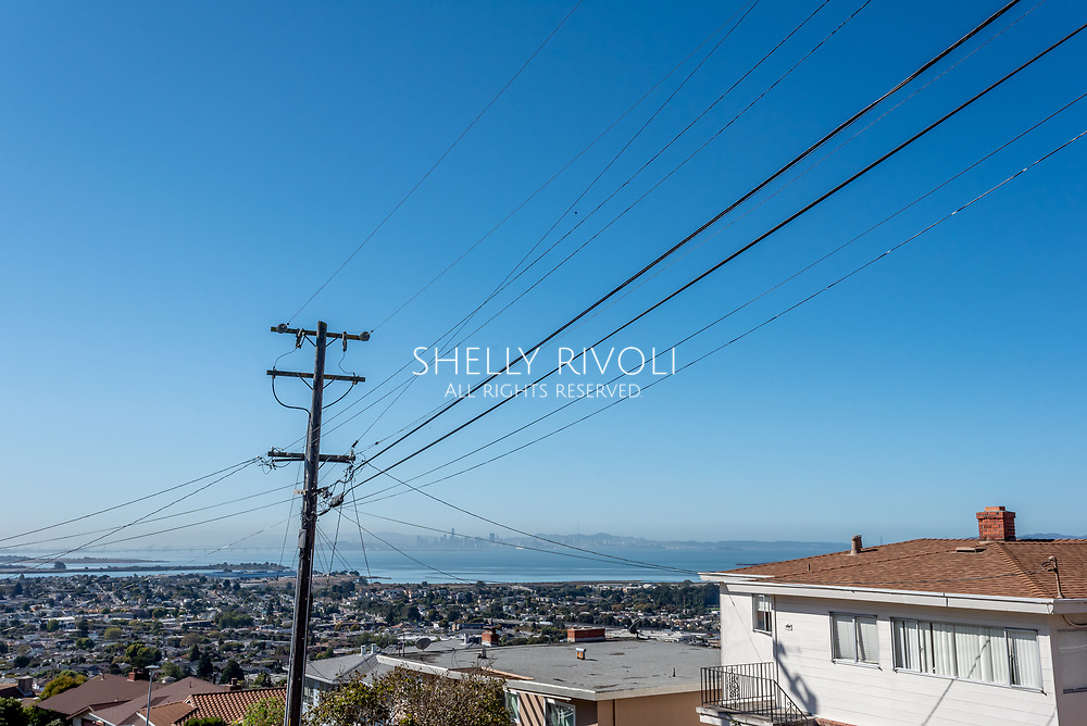 Downtown San Francisco viewed through several PG&E power lines in the East Bay neigbhorhood of El Cerrito, California.