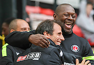 Picture by David Horn/Focus Images Ltd +44 7545 970036<br /> 14/09/2013<br /> Gianfranco Zola Manager of Watford and Chris Powell Manager of Charlton Athletic embrace before the Sky Bet Championship match at Vicarage Road, Watford.