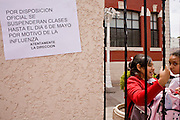 Apr. 27, 2009 -- NOGALES, SONORA, MEXICO: School children in Nogales, Sonora, Mexico, walk past a sign announcing school is closed until at least May 6 because of the outbreak of swine flu. The Mexican government broadened its efforts to control the outbreak of swine flu Monday closing schools throughout the country. In Nogales, on Mexico's northern border with the US, people started wearing masks as news of the outbreak spread.  Photo by Jack Kurtz / ZUMA Press