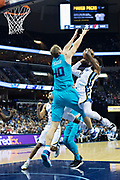 MEMPHIS, TN - OCTOBER 30:  Tyreke Evans #12 of the Memphis Grizzlies takes it to the middle against Cody Zeller #40 of the Charlotte Hornets at the FedEx Forum on October 30, 2017 in Memphis, Tennessee.  NOTE TO USER: User expressly acknowledges and agrees that, by downloading and or using this photograph, User is consenting to the terms and conditions of the Getty Images License Agreement.  The Hornets defeated the Grizzlies 104-99.  (Photo by Wesley Hitt/Getty Images) *** Local Caption *** Tyreke Evans; Cody Zeller