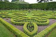 Box hedging and elaborate topiary on a grassy terrace at Pitmedden Garden, Ellon,  Aberdeenshire, Scotland, UK