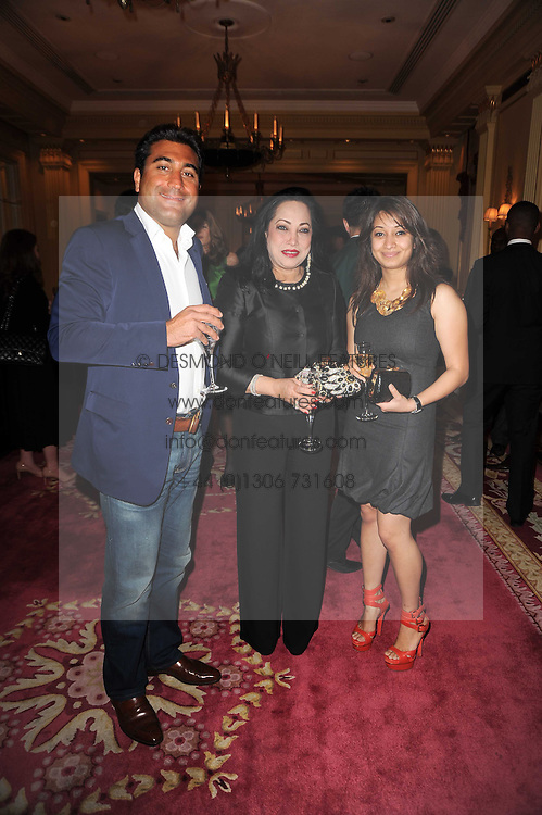 Left to right, JOHN COLLIER-BRIGHT, the BEGHAM FAWZIA KHAN and her daughter SHERFEHNAZ KHAN at a reception hosted by Films Without Borders at the Lanesborough Hotel, Hyde Park Corner, London on 27th October 2010.