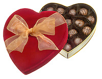 box of chocolates in a red velvet box photographed on a white background