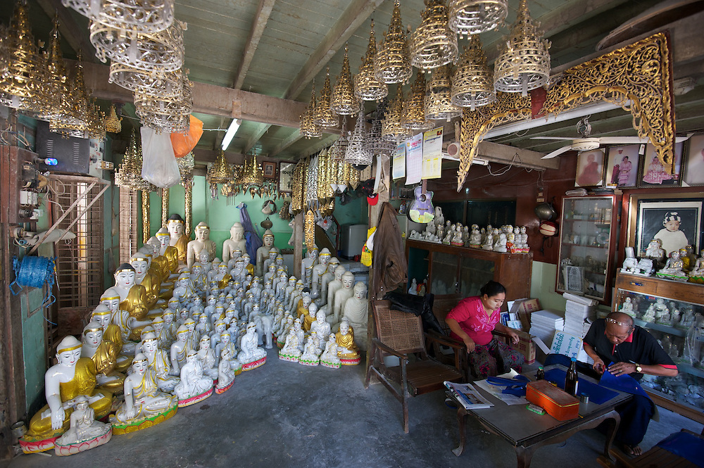 A shop selling metal and marble buddha statues, for domestic use and export, Amarapura.
