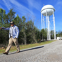 Thomas Wells | BUY at PHOTOS.DJOURNAL.COM<br /> Tupelo Water and Light employee Chris Lewis takes the one tool he needs in order to turn on the water supply for the new water tower on Purnell Road Tuesday morning.