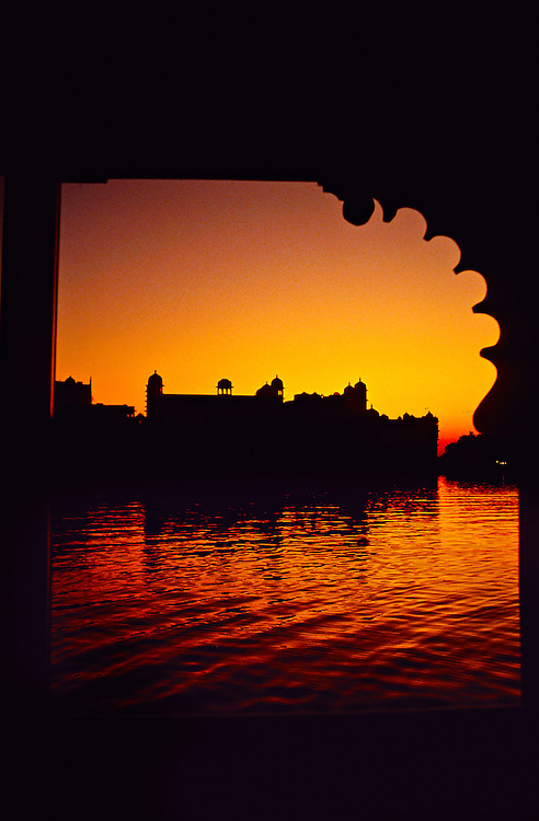 View from Room 110 of the Lake Palace Hotel to the City Palace at sunrise (on Lake Pichola), Udaipur, Rajasthan, India