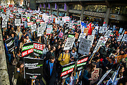 Students march through central London to demand that politicians scrap tuition fees. Here passing Kings College. The demonstration was organised by the National Campaign Against Fees and Cuts (NCAFC) and the Student Assembly Against Austerity with Students travelling to London from cities around the UK, including Aberdeen, Glasgow, Newcastle, Leeds and Sheffield. They assembled at Malet Street, where part of the University of London is based, and then marched to Whitehall, and ending outside the Houses of Parliament. London, UK 19 Nov 2014