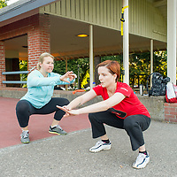 Personal trainer Angelique Tourbier of Studio Blue (left) directs Anna Rigby with her morning workout in Wallace Park (NW 25th Ave. and Raleigh St.) 6:35am
