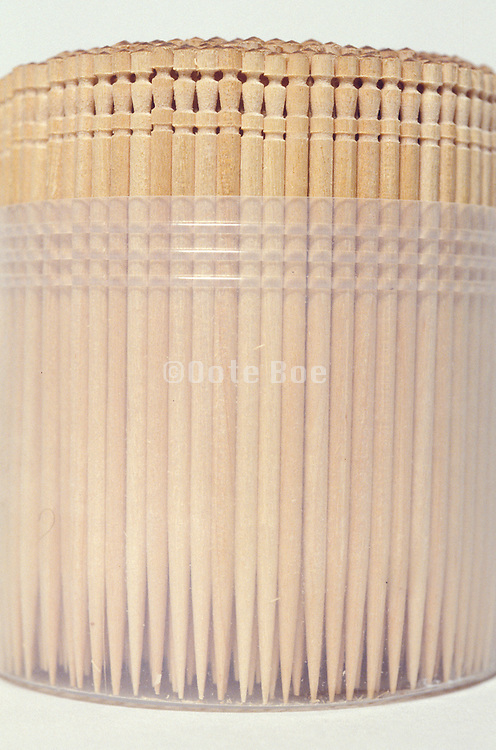 bunch of carved wooden toothpicks in plastic container