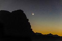 Moon rise over the rock formations at Wadi Rum, the Arabian Desert, Jordan.