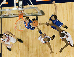 UVA's Sean Singletary (44) gets a shot off over Duke's Jon Scheyer (30).  The University of Virginia Cavaliers beat the #8 ranked Duke University Blue Devils 68-66 in overtime at the John Paul Jones Arena in Charlottesville, VA on February 1, 2007...