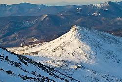 Lakes of the Clouds Hut and Mount Monroe as seen from Mount Washington in New Hampshire's White Mountains. WInter.