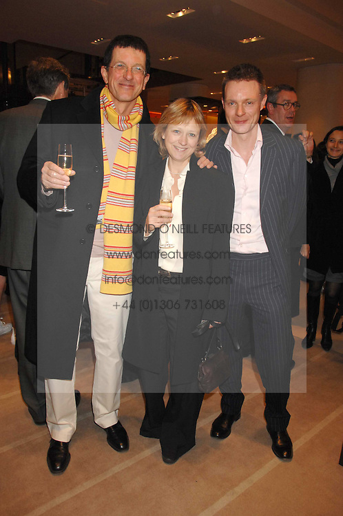 Left to right, artist ANTONY GORMLEY, his wife VICKEN PARSONS and TIM MARLOW writer, broadcaster, art historian and Director of Exhibitions at White Cube at a reception to launch the 2007 Louis Vuitton Christmas windows in collaboration with Central Saint Martins College of Art & Design held at 17-18 New Bond Street, London W1 on 7th November 2007.<br />