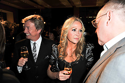 NIGEL LYTHGOE and SAMMY ? at the BAFTA Nominees party 2011 held at Asprey, 167 New Bond Street, London on 12th February 2011.