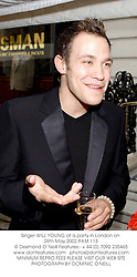 Singer WILL YOUNG at a party in London on 29th May 2002.PAM 113