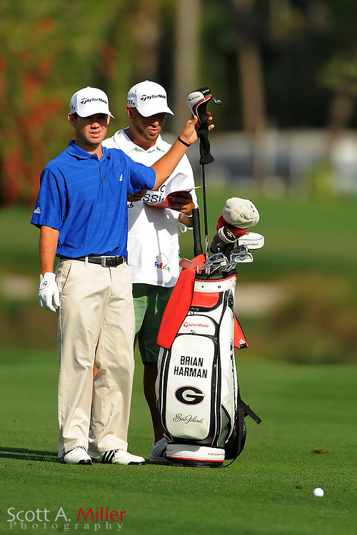 Brian Harmon and his caddie during the second round of the Honda Classic at PGA National on March 2, 2012 in Palm Beach Gardens, Fla. ..©2012 Scott A. Miller.
