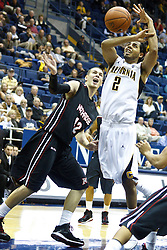 November 16, 2010; Berkeley, CA, USA;  California Golden Bears guard Jorge Gutierrez (2) and Cal State Northridge Matadors forward Michael Lizarraga (42) try to grab a loose ball during the first half at Haas Pavilion.
