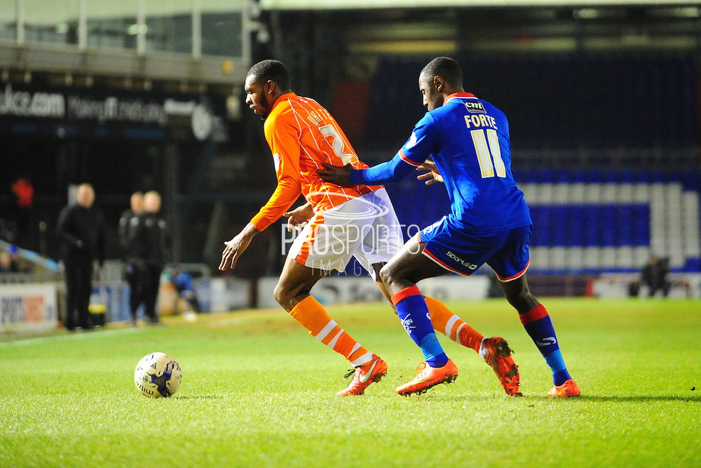 Hayden White of Blackpool FC (On loan from Bolton Wanderers) holds off Jonathan Forte of Oldham Athletic during the Sky Bet League 1 match between Oldham Athletic and Blackpool at SportsDirect.Com Park, Oldham, England on 15 March 2016. Photo by Mike Sheridan.