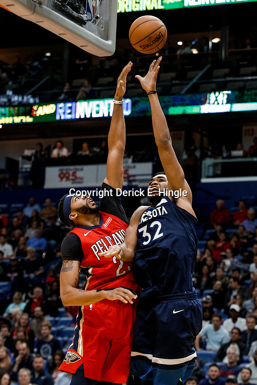 Nov 29, 2017; New Orleans, LA, USA; Minnesota Timberwolves center Karl-Anthony Towns (32) shoots over New Orleans Pelicans forward Anthony Davis (23) during the first quarter of a game at the Smoothie King Center. Mandatory Credit: Derick E. Hingle-USA TODAY Sports