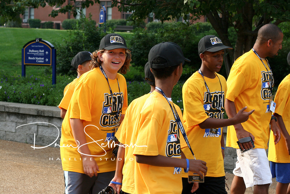 Players and KPMG Volunteers attend the opening ceremonies of the 2009 inaugural Jr. RBI Classic at the St. Louis University Soccer Stadium in St. Louis, Missouri