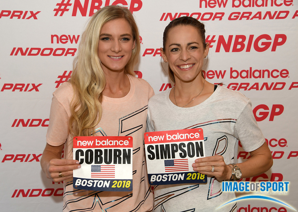 Jenny Simpson aka Jennifer Simpson (left) and Emma Coburn pose with race bibs during a  press conference prior to the New Balance Indoor Grand Prix in Boston on Friday, Feb. 9, 2018.
