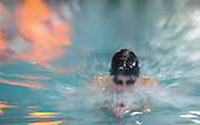 Newton South High School junior Quinn Boulerice swims breaststroke in the third leg of the 200 yard IM during the DCL meet at Atkinson Pool in Sudbury, Jan. 31, 2015.   (Wicked Local Photo/James Jesson)