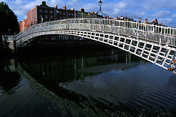 IRELAND DUBLIN JUL99 - People cross the Liffey on Dublin's symbol, the Halfpenny Bridge. The Liffey's axis, which runs from east to west, acts as a physical, social and at times psychological dividing line between Dublin's affluent south side and the impoverished north. ..jre/Photo by Jiri Rezac..© Jiri Rezac 1999..Contact: +44 (0) 7050 110 417.Mobile: +44 (0) 7801 337 683.Office: +44 (0) 20 8968 9635..Email: jiri@jirirezac.com.Web: www.jirirezac.com..© All images Jiri Rezac 1999 - All rights reserved.
