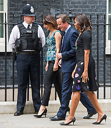 © London News Pictures. 16/06/2015. London, UK. First lady MICHELLE OBAMA being greeted by British prime minister DAVID CAMERON and his wife SAMANTHA CAMERON at 10 Downing Street in London, were the Obama's have been invited to have tea with the Cameron's. Photo credit: Ben Cawthra/LNP