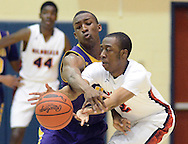 SPLYM16P<br /> Roman Catholic's Nazeer Bostick (left) attempts to poke the ball away from Plymouth Whitemarsh's Grady Minick #2 in the second quarter of a semifinal playoff game Monday March 15, 2016 at Council Rock South High School in Richboro, Pennsylvania. (William Thomas Cain/For The Inquirer)