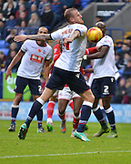 Bolton Defender, David Wheater chests back to Bolton Goalkeeper, Ben Amos during the Sky Bet Championship match between Bolton Wanderers and Bristol City at the Macron Stadium, Bolton, England on 7 November 2015. Photo by Mark Pollitt.