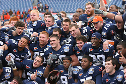 Virginia celebrates with the Music City Bowl trophy.  The Virginia Cavaliers defeated the Minnesota Golden Gophers 34-31 at the Music City Bowl in Nashville, TN on December 30, 2005.