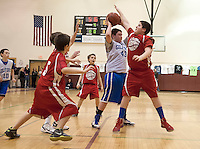 Gilford's Patrick Carr attempts to pass the ball guarded by Lou Athanas Laconia's Jacob Miner during the senior boys round at the annual Francoeur/Babcock Basketball Tournament at Gilford Middle School Friday evening.  (Karen Bobotas/for the Laconia Daily Sun)