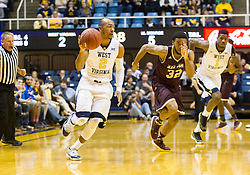 Dec 13, 2015; Morgantown, WV, USA; West Virginia Mountaineers guard Jevon Carter (2) dribbles on a fast break during the first half against the Louisiana Monroe Warhawks at WVU Coliseum. Mandatory Credit: Ben Queen-USA TODAY Sports