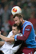 (L) Legia's Tomasz Jodlowiec fights for the ball with (R) Trabzonspor's Giray Kacar during the UEFA Europa League Group J football match between Legia Warsaw and Trabzonspor AS at Pepsi Arena Stadium in Warsaw on November 07, 2013.<br /> <br /> Poland, Warsaw, November 07, 2013<br /> <br /> Picture also available in RAW (NEF) or TIFF format on special request.<br /> <br /> For editorial use only. Any commercial or promotional use requires permission.<br /> <br /> Mandatory credit:<br /> Photo by © Adam Nurkiewicz / Mediasport