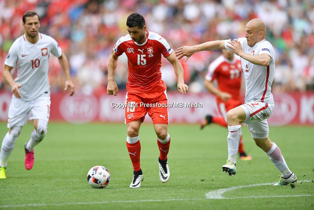 2016.06.25 Saint-Etienne<br /> Pilka nozna Euro 2016<br /> mecz 1/8 finalu Szwajcaria - Polska<br /> N/z Blerim Dzemaili Michal Pazdan<br /> Foto Lukasz Laskowski / PressFocus<br /> <br /> 2016.06.25<br /> Football UEFA Euro 2016 <br /> Round of 16 game between Switzerland and Poland<br /> Blerim Dzemaili Michal Pazdan<br /> Credit: Lukasz Laskowski / PressFocus