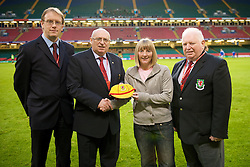 CARDIFF, WALES - Saturday, October 11, 2008: Wales' Kathryn Morgan is presented with a golden cap in recognition of winning 50 caps for Wales Women, by L-R International Development officer Mark Evans, Football Association of Wales President Peter Rees and Terry Harris, head of international committee, during the 2010 FIFA World Cup South Africa Qualifying Group 4 match at the Millennium Stadium. (Photo by David Rawcliffe/Propaganda)