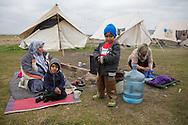 Nea Kavala, Greece - 23.03.2016  <br /> <br /> 3,515 refugees are currently living in the official Greek refugee camp in Nea Kavala. The Greek military opened the 600 tents big camp about 1 month ago. The conditions in the camp are meager : In case of rain the area is partially submerged also the tents are not heated .<br /> <br /> 3.515 Fluechtlinge leben derzeit in dem offiziellen griechischen Fluechtlingscamp in Nea Kavala. Das griechische Militaer eröffnete das aus 600 Zelten bestehende Lager etwa 1 Monat vorher. Die Bedingungen im Lager sind dürftig: Bei Regen steht das Gelaende teilweise unter Wasser außerdem sind die Zelte nicht geheizt.