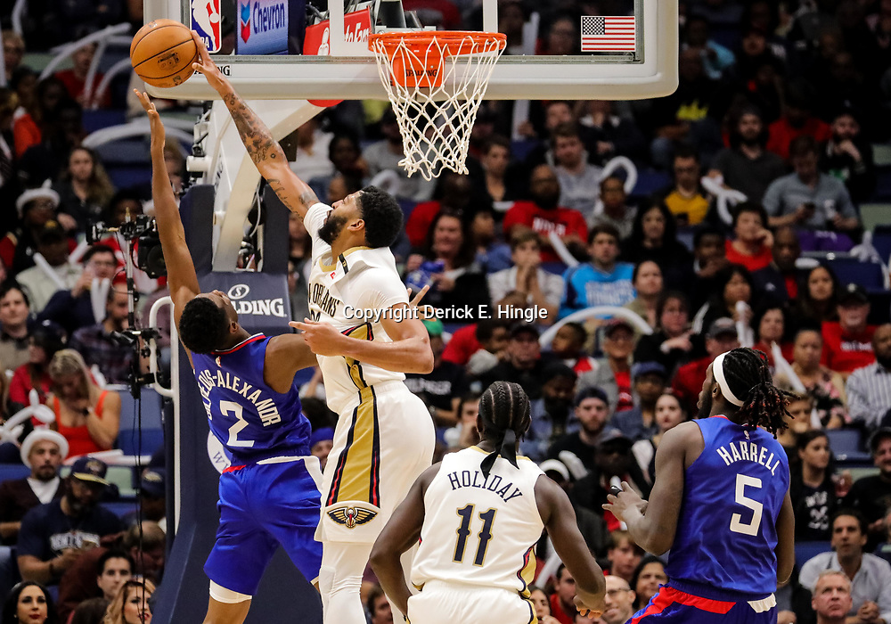 Oct 23, 2018; New Orleans, LA, USA; New Orleans Pelicans forward Anthony Davis (23) blocks a shot by Los Angeles Clippers guard Shai Gilgeous-Alexander (2) during the second half at the Smoothie King Center. The Pelicans defeated the Clippers 116-109. Mandatory Credit: Derick E. Hingle-USA TODAY Sports