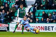 Paul McGowan (#18) of Dundee is fouled by Lewis Stevenson (#16) of Hibernian during the Ladbrokes Scottish Premiership match between Hibernian and Dundee at Easter Road, Edinburgh, Scotland on 24 November 2018.