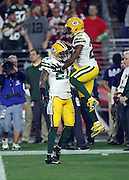 Green Bay Packers cornerback Casey Hayward (29) jumps and celebrates with Green Bay Packers free safety Ha Ha Clinton-Dix (21) after Clinton-Dix intercepts a third quarter pass at the Packers 19 yard line during the NFL NFC Divisional round playoff football game against the Arizona Cardinals on Saturday, Jan. 16, 2016 in Glendale, Ariz. The Cardinals won the game in overtime 26-20. (©Paul Anthony Spinelli)