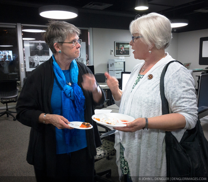 A reception was held for Rita Reed, photojournalism professor at the Missouri School of Journalism, to celebrate her retirement after 16 years of being on the faculty. <br /> <br /> In this photo, Reed (left) speaks with retired photojournalism professor C. Zoe Smith  during the reception.<br /> <br /> The event was held on May 10, 2017 in the Cliff and Vi Edom Photojournalism Lab in Lee Hills Hall on the University of Missouri campus in Columbia, Mo.<br /> <br /> The following is from Reed&rsquo;s bio posted on the Missouri School of Journalism website: &quot;Rita Reed joined the photojournalism faculty in 2001 after 20 years as a working photojournalist with Star Tribune in Minneapolis and The Gazette in Cedar Rapids, Iowa. She has worked not only on local, regional and national stories, but also internationally in Haiti, Bolivia, Colombia, Taiwan, China and the countries of the former Eastern Block.<br /> <br /> Reed holds a master&rsquo;s degree in journalism from the University of Missouri and an undergraduate degree from Southwest Missouri State University. She was the 1993 recipient of the Nikon Sabbatical Grant for Documentary Photography for the completion of work on a photographic book about gay and lesbian teenagers. Reed maintains an interest in and concern for adolescents and the issues they face. She is the director of the College Photographer of the Year competition.&rdquo;