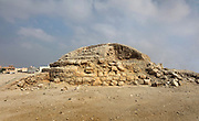 Chieftain mound, 2200-1750 BC, an early Dilmun tomb at the Janabiyah Burial Mound Field, part of the Dilmun Burial Mounds site, Janabiyah, Bahrain. This is 1 of 5 Chieftain Mounds, up to 26m wide, where people were buried above ground in the foetal position with a small alcove containing offerings, usually pottery, in 2 tiered chambers. The Janabiyah tombs were constructed for residents of the villages of Saar and Budaiya. These tombs are at risk, due to the planned construction of a shopping mall. Picture by Manuel Cohen
