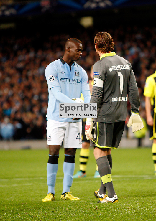 Dortmund keeper Roman Weidenfeller tries to put City striker Mario Balotelli off taking the penalty.