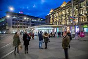 People waiting for tram and bus at the Bankplatz stop. Zurich is by far the biggest city in Switzerland, with a population near 1.83 million in the metropolitan area. It is also the finacial center in Switzerland.