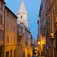 A narrow street and church at twilight in the Panier neighborhood of Marseille, France.