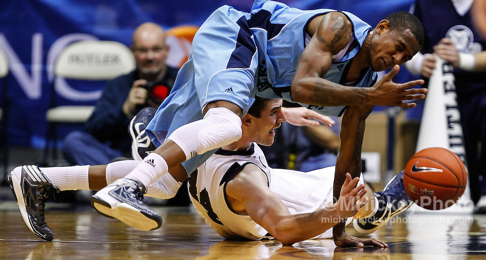 INDIANAPOLIS, IN - FEBRUARY 02: Xavier Munford #5 of the Rhode Island Rams and Andrew Smith #44 of the Butler Bulldogs battle for a loose ball at Hinkle Fieldhouse on February 2, 2013 in Indianapolis, Indiana. (Photo by Michael Hickey/Getty Images) *** Local Caption *** Xavier Munford; Andrew Smith
