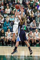 21 February 2015:  Mikaela Eppard can't stop the fade away shot by Moly McGraw during an NCAA women's division 3 CCIW basketball game between the Elmhurst Bluejays and the Illinois Wesleyan Titans in Shirk Center, Bloomington IL